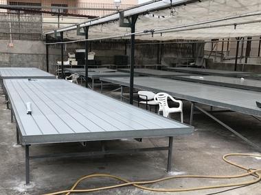 Instalacion de fondos inundables en mesas antiguas para riego en asociación de discapacitados en Madrid